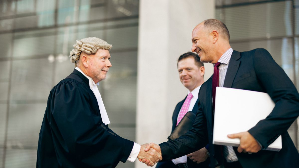 Shaun shaking judge's hand